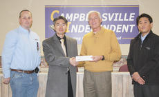 "<div class=""source""></div><div class=""image-desc"">Pictured from left are Brian Bland, general manager; JoongSeon Choi, COO; Mike Deaton, superintendent of Campbellsville schools; and Jun Kwon Park, director.</div><div class=""buy-pic""></div>"