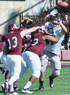 "<div class=""source"">Bobby Brockman</div><div class=""image-desc"">Nathan Cooper (13) uses a block from Caleb Croney (63) to complete a pass for Campbellsville U. in the  Fighting Tigers' 20-13 setback to Cumberlands.</div><div class=""buy-pic""><a href=""http://web2.lcni5.com/cgi-bin/c2newbuyphoto.cgi?pub=085&orig=DSC_0012_1.jpg"" target=""_new"">Buy this photo</a></div>"