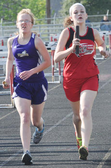"""<div class=""""source"""">Bobby Brockman</div><div class=""""image-desc"""">Campbellsville's Beth Baker and Taylor Ware of Taylor County battle in a relay race at the conference meet.</div><div class=""""buy-pic""""><a href=""""http://web2.lcni5.com/cgi-bin/c2newbuyphoto.cgi?pub=085&orig=DSC_0015_5.jpg"""" target=""""_new"""">Buy this photo</a></div>"""