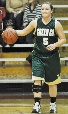 """<div class=""""source"""">Bobby Brockman</div><div class=""""image-desc"""">Micah Jones, who inked during the November signing period with Western Kentucky University, combined with junior backcourt mate to score 36 points in Green County's 71-31 romp over home-standing Taylor County.</div><div class=""""buy-pic""""><a href=""""/photo_select/34582"""">Buy this photo</a></div>"""