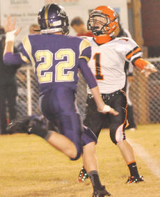 """<div class=""""source"""">Bobby Brockman</div><div class=""""image-desc"""">Grant Adams (22) goes in for one of his three sacks during Campbellsville High School's 48-6 romp over Lynn Camp on Friday night. With the win, coach Dale Estes' Eagles need a triumph over visiting Berea, this Friday night at 7:30, to clinch a home-field play-off game when post-season play starts on Friday, Nov. 2.</div><div class=""""buy-pic""""><a href=""""/photo_select/40735"""">Buy this photo</a></div>"""