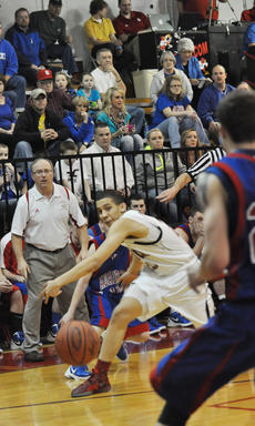 """<div class=""""source"""">Bobby Brockman</div><div class=""""image-desc"""">Austin Webster passes the ball inside during the first half of the win vs. Adair County.</div><div class=""""buy-pic""""><a href=""""/photo_select/35866"""">Buy this photo</a></div>"""