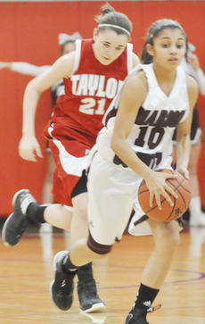 """<div class=""""source"""">Bobby Brockman</div><div class=""""image-desc"""">Haeli Howard (10)  out-races Taylor County's Summer Bailey in Marion County's 65-26 romp over the Lady Cardinals.</div><div class=""""buy-pic""""><a href=""""/photo_select/42877"""">Buy this photo</a></div>"""