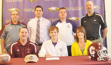 """<div class=""""source"""">Bobby Brockman</div><div class=""""image-desc"""">Campbellsville High School kicker Bradley Bates signed to play for Campbellsville University on Wednesday morning. Joining him the 8:30 a.m. signing ceremony are his parents, Keith and Vanessa Adkins and back, from left: CU recruiting coordinator Jim Hardy, CHS principal Kirby Smith, Eagles'; head football coach Dale Estes and CHS athletics director Tim Davis. Bates is also the son of Jeremy Bates.</div><div class=""""buy-pic""""><a href=""""/photo_select/42596"""">Buy this photo</a></div>"""