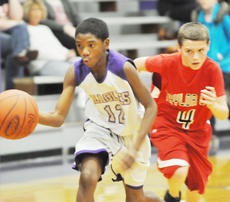 "<div class=""source"">Bobby Brockman</div><div class=""image-desc"">Tyrion Taylor (12) heads down court for the Eagle seventh graders against Cardinal Marcus Moore (4).</div><div class=""buy-pic""><a href=""http://web2.lcni5.com/cgi-bin/c2newbuyphoto.cgi?pub=085&orig=DSC_0052_2.jpg"" target=""_new"">Buy this photo</a></div>"