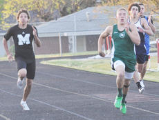 """<div class=""""source"""">Bobby Brockman</div><div class=""""image-desc"""">Green County junior Evan Jaggers won the 100- and 200-meter dashes plus the triple jump and was second in the long jump at the Heartland Athletic Conference Track Meet at Taylor County.</div><div class=""""buy-pic""""><a href=""""http://web2.lcni5.com/cgi-bin/c2newbuyphoto.cgi?pub=085&orig=DSC_0056_0.jpg"""" target=""""_new"""">Buy this photo</a></div>"""