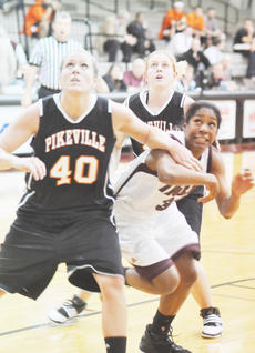 "<div class=""source"">Dennis George</div><div class=""image-desc"">Lady Tiger Corin Dunn (32) maneuvers for a rebound vs. Pikeville.</div><div class=""buy-pic""><a href=""/photo_select/27184"">Buy this photo</a></div>"