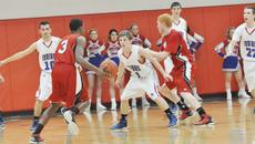 """<div class=""""source"""">Bobby Brockman</div><div class=""""image-desc"""">Taylor County freshman Quentin Goodin goes against Adair County's Marshall Shelley (10) and Matt Fudge (11) during the Cardinals' 40-38 overtime victory over the Indians on Tuesday.</div><div class=""""buy-pic""""><a href=""""/photo_select/42365"""">Buy this photo</a></div>"""