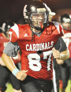 "<div class=""source"">Bobby Brockman</div><div class=""image-desc"">Logan Perry's touchdown reception from Hunter Christie gave the Cardinals a 35-12 cushion en route to a 42-12 romp.</div><div class=""buy-pic""><a href=""/photo_select/39879"">Buy this photo</a></div>"