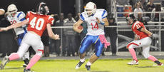 """<div class=""""source"""">Bobby Brockman</div><div class=""""image-desc"""">Cody Bast (40) and Jared Peake (31)  try to corral Mercer County quarterback J.T. Long (14) during Taylor County 43-7 home loss to the Titans. </div><div class=""""buy-pic""""><a href=""""http://web2.lcni5.com/cgi-bin/c2newbuyphoto.cgi?pub=085&orig=DSC_0077.jpg"""" target=""""_new"""">Buy this photo</a></div>"""