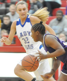 """<div class=""""source"""">Bobby Brockman</div><div class=""""image-desc"""">Adair County's Mercedes Cox (32) applies defensive pressure against Kiyah Barnett (12) of Campbellsville during the Lady Indians' 74-30 rout in first-round 20th District Tournament action  on Thursday. Marion County downed Adair County 72-41 for the championship title on Saturday.</div><div class=""""buy-pic""""><a href=""""/photo_select/42878"""">Buy this photo</a></div>"""