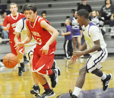 "<div class=""source"">Bobby Brockman</div><div class=""image-desc"">Justice Gregory (23) drives for the Cardinal eighth graders vs. Eagle Kendon Young (21). Gregory had a game-high 20 points.</div><div class=""buy-pic""><a href=""http://web2.lcni5.com/cgi-bin/c2newbuyphoto.cgi?pub=085&orig=DSC_0095.jpg"" target=""_new"">Buy this photo</a></div>"