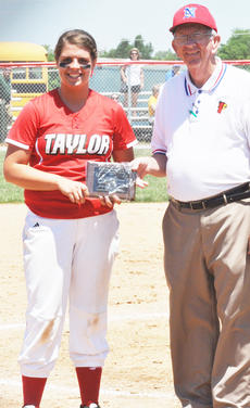 """<div class=""""source"""">Bobby Brockman</div><div class=""""image-desc"""">Shelby Carney had three consecutive hits in the Taylor County Lady Cardinals' 6-5 loss to Green County in the first game of the Fifth Region Tournament on Monday at Nelson County High School. Awarding Carney, a junior first-baseman, with her All-Fifth Region Tournament plaque is Nelson County athletics director Bill Broaddus. Central Hardin defeated North Hardin 10-0 for the Fifth Region Tournament softball championship.</div><div class=""""buy-pic""""><a href=""""/photo_select/44766"""">Buy this photo</a></div>"""
