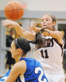 "<div class=""source"">Richard RoBards</div><div class=""image-desc"">Lady Tiger sophomore Katie Allen dishes out one of her nine assists vs. Lindsey Wilson.</div><div class=""buy-pic""></div>"