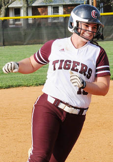 "<div class=""source"">Richard RoBards</div><div class=""image-desc"">Courtney Turpin rounds third after her walk-off home run.</div><div class=""buy-pic""></div>"