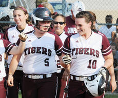 "<div class=""source"">Richard RoBards</div><div class=""image-desc"">Courtney Turpin is congratulated after her walk-off home run in game two.</div><div class=""buy-pic""></div>"