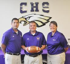 """<div class=""""source"""">Bobby Brockman</div><div class=""""image-desc"""">Dale Estes, center, is officially named Campbellsville High School's head football coach by CHS principal Kirby Smith, left, and acting athletics director Katie Wilkerson.</div><div class=""""buy-pic""""><a href=""""/photo_select/39114"""">Buy this photo</a></div>"""