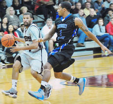 "<div class=""source"">Richard RoBards</div><div class=""image-desc"">Darius Clement drives against Lindsey Wilson's Kalen Kimberland during Campbellsville University's first setback of the season.</div><div class=""buy-pic""></div>"