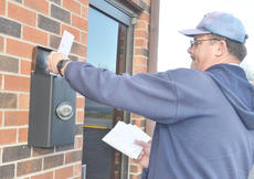 """<div class=""""source"""">Calen McKinney</div><div class=""""image-desc"""">City mail carrier Randell Sullivan delivers mail last Thursday morning. Beginning in August, the United States Postal Service announced last week, mail will no longer be delivered on Saturday.</div><div class=""""buy-pic""""><a href=""""/photo_select/42566"""">Buy this photo</a></div>"""