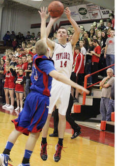 """<div class=""""source"""">George Spragens</div><div class=""""image-desc"""">Caleb Wigginton connects on a jumper during Taylor County's two-point triumph.</div><div class=""""buy-pic""""><a href=""""/photo_select/35863"""">Buy this photo</a></div>"""