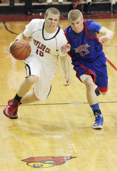 """<div class=""""source"""">George Spragens</div><div class=""""image-desc"""">Trae Wells heads down court against Justin Reeder in Taylor County's 53-51 20th District Tournament victory over Adair County.</div><div class=""""buy-pic""""><a href=""""/photo_select/35840"""">Buy this photo</a></div>"""