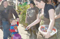 """<div class=""""source"""">Calen McKinney</div><div class=""""image-desc"""">Citizens Bank and Trust Co. employees pass out candy to trick-or-treaters but also dress in costumes, from the Turtleman and witches and more.</div><div class=""""buy-pic""""><a href=""""/photo_select/41079"""">Buy this photo</a></div>"""