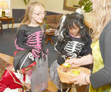 """<div class=""""source"""">Calen McKinney</div><div class=""""image-desc"""">Trick-or-treaters get candy from Nunery & Call PLLC law firm.</div><div class=""""buy-pic""""><a href=""""/photo_select/41082"""">Buy this photo</a></div>"""