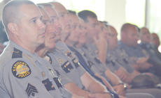 "<div class=""source"">Calen McKinney</div><div class=""image-desc"">Law enforcement officers from several agencies attended Wednesday's ceremony to honor one of their fallen brothers.</div><div class=""buy-pic""><a href=""/photo_select/44485"">Buy this photo</a></div>"