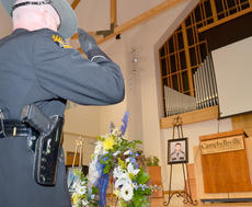 "<div class=""source"">Calen McKinney</div><div class=""image-desc"">Kentucky State Police honor guard members salute a photo of the late Johnny Edrington II during a ceremony honoring the 25th anniversary of his death. A state trooper, he was killed in 1988 during a traffic stop. His killer has yet to be apprehended.</div><div class=""buy-pic""><a href=""/photo_select/44488"">Buy this photo</a></div>"
