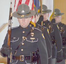 "<div class=""source"">Calen McKinney</div><div class=""image-desc"">Kentucky State Police honor guard members present the colors.</div><div class=""buy-pic""><a href=""/photo_select/44491"">Buy this photo</a></div>"