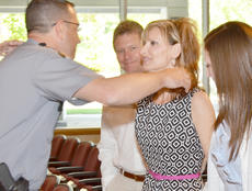 "<div class=""source"">Calen McKinney</div><div class=""image-desc"">Kentucky State Police Public Affairs Officer Billy Gregory hugs Diane Chandler, the former wife of Johnny Edrington II, after Wednesday's ceremony.</div><div class=""buy-pic""><a href=""/photo_select/44492"">Buy this photo</a></div>"