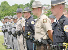 """<div class=""""source"""">Calen McKinney</div><div class=""""image-desc"""">Many Campbellsville Police, Taylor County Sheriff's and Kentucky State Police officials attend the ceremony to honor Edrington's memory.</div><div class=""""buy-pic""""><a href=""""/photo_select/37725"""">Buy this photo</a></div>"""