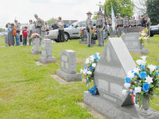 """<div class=""""source"""">Calen McKinney</div><div class=""""image-desc"""">Many law enforcement officials and family members of the late Johnny Edrington II gather before Tuesday's ceremony to mark the nearly 24 years that have passed since he was killed in the line of duty.</div><div class=""""buy-pic""""><a href=""""/photo_select/37726"""">Buy this photo</a></div>"""