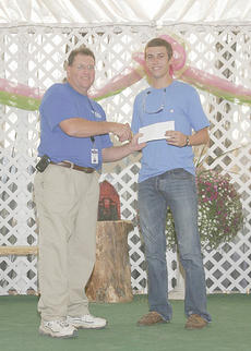 """<div class=""""source""""></div><div class=""""image-desc"""">Lake Wiseman, a Campbellsville High School graduate, was awarded a $1,000 scholarship by the Taylor County Fair Association. Each year, the fair association awards scholarships to two deserving seniors, one from CHS and one from Taylor County High School. The awards were presented by Mike Litchfield, president of the Taylor County Fair Association.</div><div class=""""buy-pic""""></div>"""
