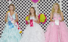 """<div class=""""source""""></div><div class=""""image-desc"""">Jayin Loy, at left, was named Miss Pre-Teen Taylor County Fair. Lauren Barrett, not pictured, was named Miss Teen. Destiny Guffey was named Miss Taylor County Fair. Her photo appeared in the June 6 issue.</div><div class=""""buy-pic""""></div>"""