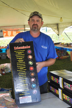 "<div class=""source"">Leslie Moore</div><div class=""image-desc"">Joey Rainwater shows some of the fireworks available for sale at the Lewis Enterprises fireworks stand near Burger King.</div><div class=""buy-pic""><a href=""/photo_select/45456"">Buy this photo</a></div>"