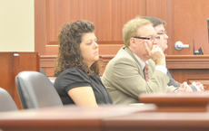 """<div class=""""source"""">Calen McKinney</div><div class=""""image-desc"""">Tonya Ford, at left, listens to testimony on Monday with her attorney, Danny Butler of Greensburg, center, and his associate, Jeremy Wood.</div><div class=""""buy-pic""""><a href=""""http://web2.lcni5.com/cgi-bin/c2newbuyphoto.cgi?pub=085&orig=Ford%2BTrial%2B1.jpg"""" target=""""_new"""">Buy this photo</a></div>"""