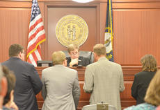 """<div class=""""source"""">Calen McKinney</div><div class=""""image-desc"""">The defense and prosecution meet Tuesday morning before Taylor Circuit Court Judge Dan Kelly to argue an issue in Tonya Ford's murder trial. From left are defense attorneys Jeremy Wood and Danny Butler of Greensburg and prosecutors Assistant Commonwealth's Attorneys John Miller and Angela Call.</div><div class=""""buy-pic""""><a href=""""http://web2.lcni5.com/cgi-bin/c2newbuyphoto.cgi?pub=085&orig=Ford%2BTrial%2B2.jpg"""" target=""""_new"""">Buy this photo</a></div>"""