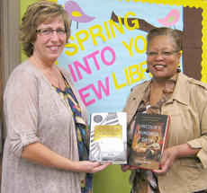 "<div class=""source""></div><div class=""image-desc"">At right, GCU Executive Director Wanda Washington presents the books to Adult Services Librarian Debbie Parson.</div><div class=""buy-pic""></div>"