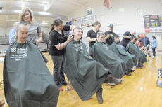 "<div class=""source"">Richard RoBards</div><div class=""image-desc"">From left are Kent Skaggs being shaved by Rhiannon McQueary, Morgan Wilson shaved by Danielle Matney, John Moore shaved by Jessica Matney, Carlos Vazquez shaved by Zack Gilbert and Jason Cox being shaved by Wes Bishop. Cox, Moore and Skaggs were on the Kroger in Green River Plaza team.</div><div class=""buy-pic""></div>"