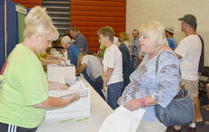 """<div class=""""source"""">Calen McKinney</div><div class=""""image-desc"""">Nearly 1,300 people attended Saturday's health fair sponsored by Taylor Regional Hospital. The health fair offered complete blood count and comprehensive  metabolic, thyroid stimulating hormone and coronary risk profiles, as well as several booths with information from local medical organizations.</div><div class=""""buy-pic""""><a href=""""/photo_select/38606"""">Buy this photo</a></div>"""