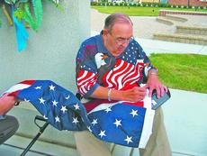 "<div class=""source"">Patrick Keefe</div><div class=""image-desc"">In 1958, Bob Heft, then a 17-year-old high school junior, turned a history class project into a history-making event when he designed what is now America's flag.</div><div class=""buy-pic""><a href=""http://web2.lcni5.com/cgi-bin/c2newbuyphoto.cgi?pub=085&orig=Heft%2Bflag.jpg"" target=""_new"">Buy this photo</a></div>"