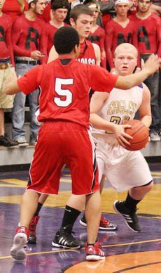 "<div class=""source"">Dennis George</div><div class=""image-desc"">Eagle Mason Wethington is trapped by Spirit Smith (5) and Caleb Wigginton of the Cardinals during Friday night Taylor County at Campbellsville girl/boy basketball action.</div><div class=""buy-pic""><a href=""/photo_select/34938"">Buy this photo</a></div>"