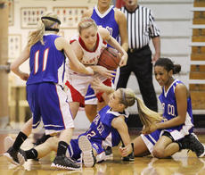 "<div class=""source"">Dennis George</div><div class=""image-desc"">Rachel Riggs wrestles the ball away from Lady Indian defenders Preslie Lawless, Kassidi Taylor and Hali Wheat during Taylor County's 67-50 20th District Tournament loss to Adair County.</div><div class=""buy-pic""><a href=""/photo_select/35839"">Buy this photo</a></div>"