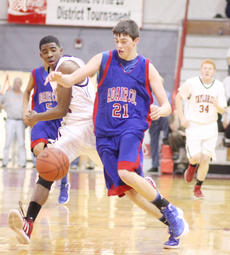 """<div class=""""source"""">Dennis George</div><div class=""""image-desc"""">Quentin Goodin battles Adair County's Chance Melton for a ball during Wednesday's Taylor County victory.</div><div class=""""buy-pic""""><a href=""""/photo_select/35865"""">Buy this photo</a></div>"""