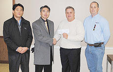 "<div class=""source""></div><div class=""image-desc"">From left are Jun Kwon Park, director at INFAC, Joongseon Choi, chief operations officer, Taylor County Superintendent Roger Cook and Brian Bland, INFAC plant manager.</div><div class=""buy-pic""></div>"