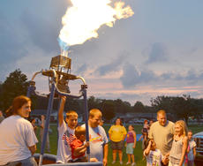 """<div class=""""source"""">Calen McKinney</div><div class=""""image-desc"""">Though balloonists weren't able to provide tethered rides on Wednesday night, residents were still able to sit inside the balloons and see them glow. And some children were able to ignite the flames that keep the balloons afloat.</div><div class=""""buy-pic""""><a href=""""http://web2.lcni5.com/cgi-bin/c2newbuyphoto.cgi?pub=085&orig=July%2BThird-Balloons%2BFlame.jpg"""" target=""""_new"""">Buy this photo</a></div>"""