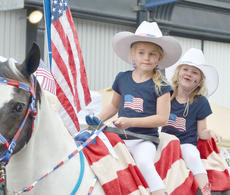 """<div class=""""source"""">Calen McKinney</div><div class=""""image-desc"""">Kimber Gabehart, at left, and Lexi Gilbert of Campbellsville ride atop a horse in the Children's Parade on Wednesday night.</div><div class=""""buy-pic""""><a href=""""http://web2.lcni5.com/cgi-bin/c2newbuyphoto.cgi?pub=085&orig=July%2BThird-Parade%2BHorse.jpg"""" target=""""_new"""">Buy this photo</a></div>"""