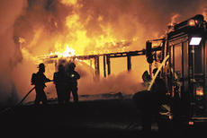 """<div class=""""source"""">Rick Wilson</div><div class=""""image-desc"""">Just after midnight Saturday, a fire claimed the home and belongings of a Campbellsville family. Their pets also died.</div><div class=""""buy-pic""""><a href=""""http://web2.lcni5.com/cgi-bin/c2newbuyphoto.cgi?pub=085&orig=KY%2B210%2Bfire.jpg"""" target=""""_new"""">Buy this photo</a></div>"""