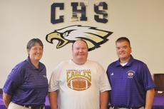 """<div class=""""source"""">Bobby Brockman</div><div class=""""image-desc"""">Three die-hard Eagles and Campbellsville High School graduates, from left: Katie Wilkerson, James Rice and Dale Estes, get together at the ceremony officially hiring Estes as the Eagles' next head football coach on Tuesday. Wilkerson is the school's acting athletics director while Rice was an Eagle football manager at Campbellsville through 1986 before going to Eastern Kentucky University in the same capacity.</div><div class=""""buy-pic""""><a href=""""/photo_select/39115"""">Buy this photo</a></div>"""
